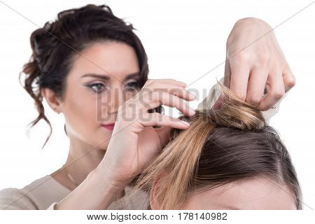 Working hairdresser and client on white background