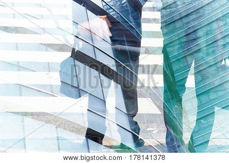 Abstract double exposure of businessman and office buildings