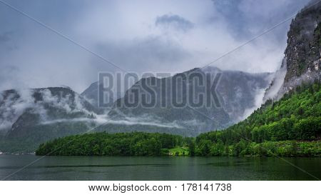 Clouds And Rain Over Mountain Lake In Hallstatt, Europe