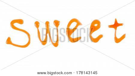 Word sweet written with caramel sauce over white background