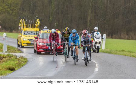 Chateau-RenardFrance - March 062017: Five cyclists in the breakaway (Tony Galopin of Lotto Soudal Evaldas Siskevicius of Delko Marseille Provence KTMSven Erik Bystrom of Katusha AlpecinMaartin Wynants of Lotto NL-JumaboPhilippe Gilbert of Quick-Step Floor