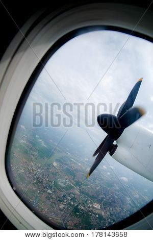 engine and propeller of the plane view from window airplane