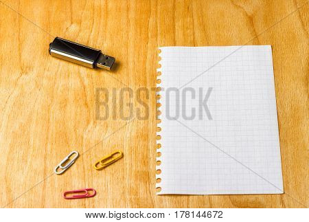 A student on the desk accessories for education and business store information display his thoughts on a blank sheet of paper a place for abstracts