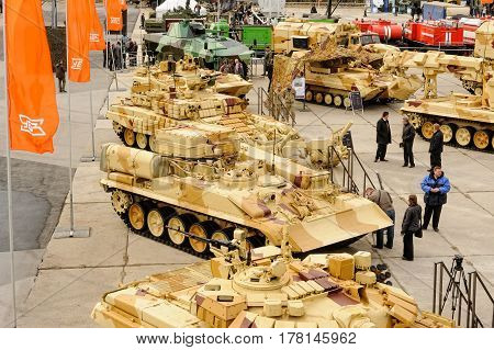 Nizhniy Tagil, Russia - September 25. 2013: Visitors explore military equipment on exhibition range. RAE-2013 exhibition.