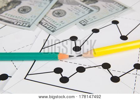 Business drawing chart graphics dollars and panils
