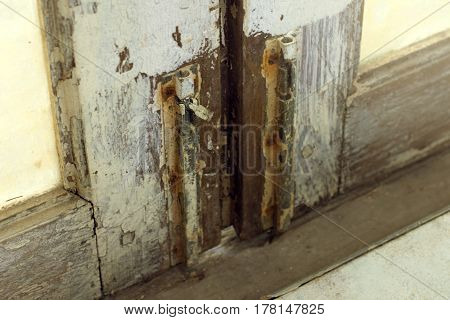 A latch of bar lock at the old wooden door