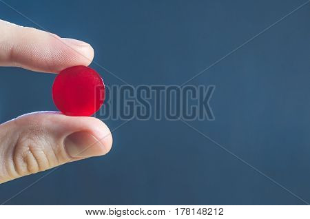 Lollipop Pill For Medicine In Fingers Close Up