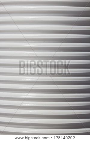 A close up view of plastic cups creating a lined pattern