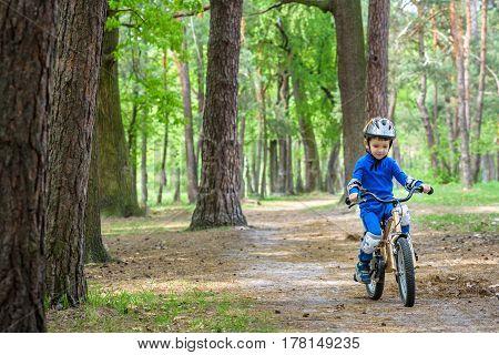 Happy Cute Blond Kid Boy Having Fun His First Bike On Sunny Summ