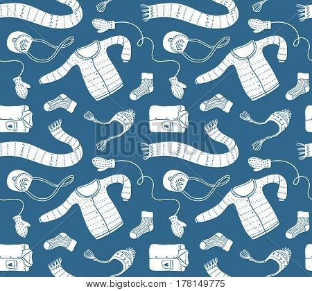 Cute vector collection of handmade clothes isolated on the blue background. Vector seamless pattern.