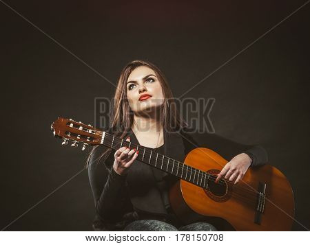 Disabled girl playing guitar. Young female musican on wheelchair. Hobby passion music relax concept.