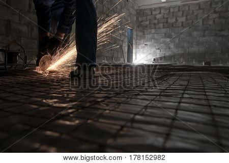 Work of electric saw for metal shot in studio being repaired sparks all around worker