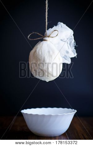 cottage cheese in cheesecloth on a black background
