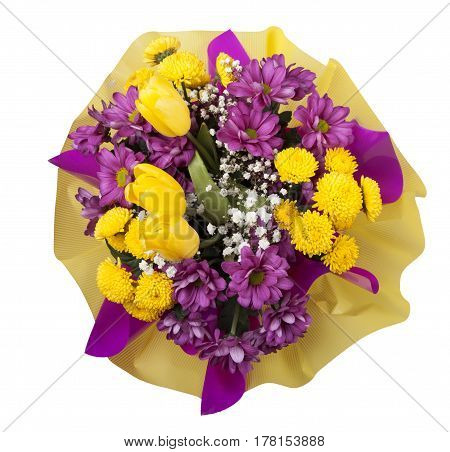 Beautiful bouquet of yellow and purple chrysanthemums with yellow tulips in a box on a white background top view