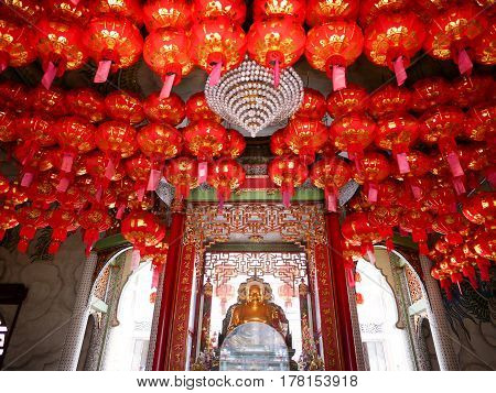 Chinese red lanterns hang for decorate the ceiling inside temple