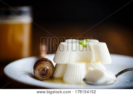 sweet dessert panna cotta with honey on a wooden table