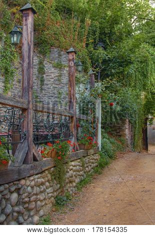 Rustic terrace near a footpath in a small touristic town.