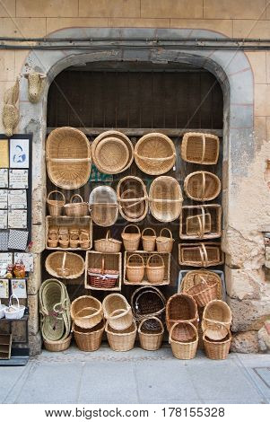 SEGOVIA SPAIN - FEBRUARY 11 2017: Wicker hand-made baskets at the shop of a touristic street of Segovia Castilla and Leon Spain.