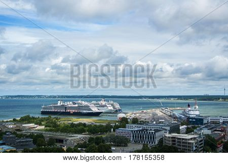 TALLINN ESTONIA - JULY 22 2015: Ferryboat terminal of Port of Tallinn and big cruise ships a view from observation deck at the center of city Tallinn Estonia.