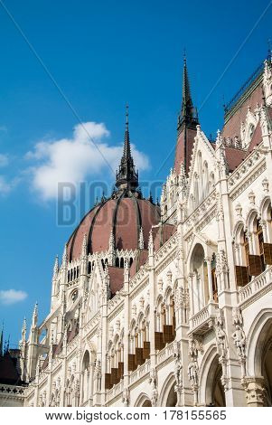 Close-up view to a dome of Hungarian Parliament building and its details Budapest Hungary.