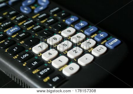 The keys and number pad of a graphing calculator