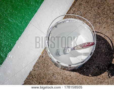 Paint brush on ground of the sports arena