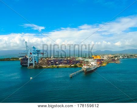 Pointe-a-Pitre, Guadeloupe - February 09, 2013: Cargo ship docked in the port of Pointe-a-Pitre in Guadeloupe