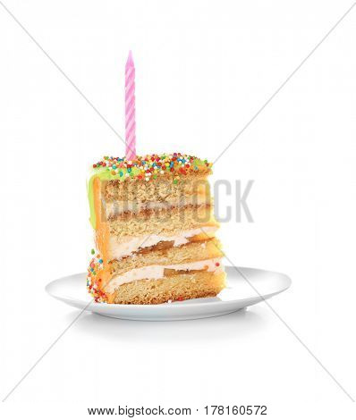 Slice of birthday cake with candle on white background