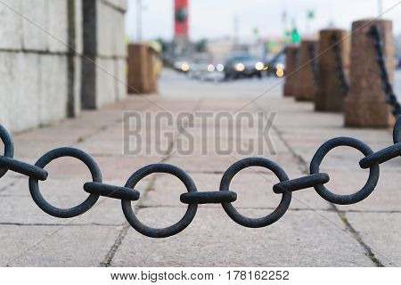 the old fence of chain on the street.