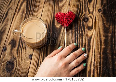 a woman hand bright manicure cup of coffee handmade heart