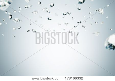 Picture of diamonds of different sizes floating in the air against a gray background. Mock up