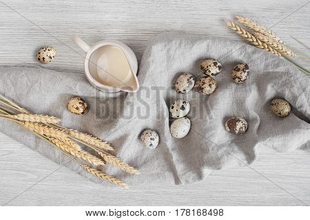 Jag Of Milk, Quail Eggs And Wheat On The Linen Napkin