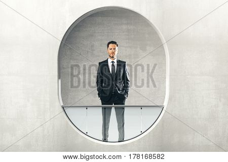 Businessman looking out of abstract round window with railing. 3D Rendering