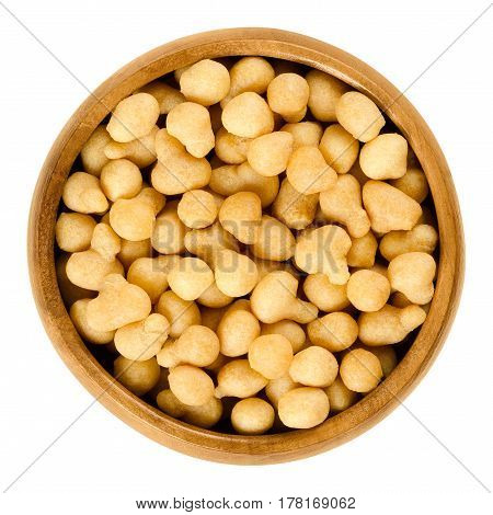 Fried batter pearls in a wooden bowl. Crispy pearls. A soup topping and snack product made from flour, vegetable fat and yeast. Isolated macro food photo close up from above on white background.