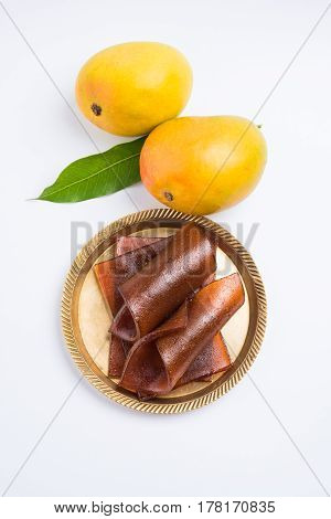 indian alphonso mango's dried jelly called mango papad or mango poli or slab or cake, traditional maharashtrian recipe
