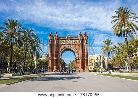 BARCELONA, SPAIN - OCTOBER 22, 2015: The Arc de Triomf is a triumphal arch in the city of Barcelona in Catalonia Spain. The arch is built in reddish brickwork in the Neo-Mudejar style