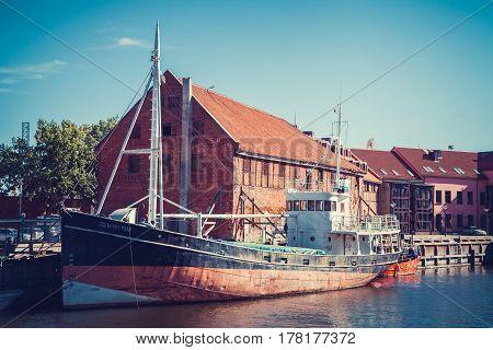 LITHUANIA KLAIPEDA - JULY 20 2016: boat on Dane river in oldtown of Klaipeda. Lithuania.