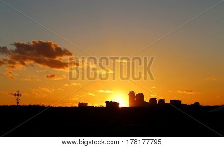 Photo of a bright sunset over the city in March