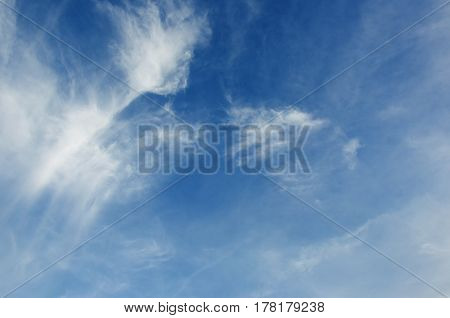 Blue sky with white clouds. Horizontal format.
