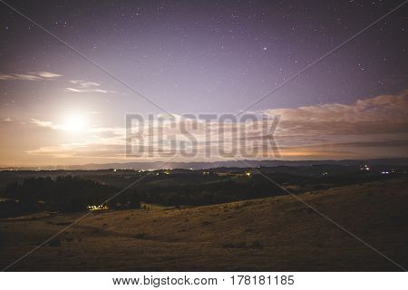 Bright Moon In Night Sky Over Rural Farm Land