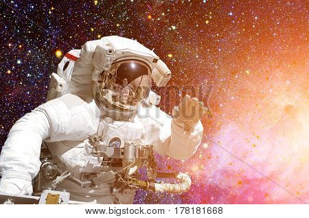 Astronaut in outer space against the backdrop of the outer space. Elements of this image furnished by NASA
