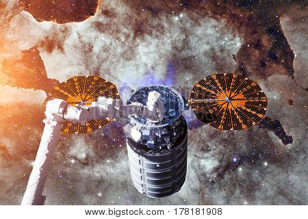 Cargo spacecraft - The Automated Transfer Vehicle over spiral galaxy. Elements of this image furnished by NASA.
