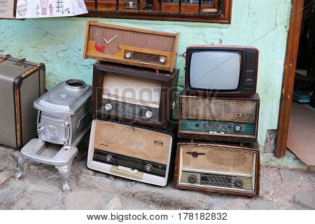 Old Radios and Television in Front of Antique Shop
