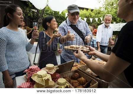 Diverse People Eating Testing Sample Homemade Bread