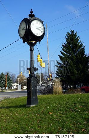 MANCELONA, MICHIGAN / UNITED STATES - NOVEMBER 27, 2016: The municipal clock provides the time in downtown Mancelona.