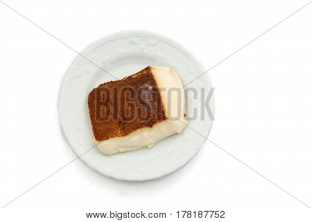 Kazandibi (surface burnt pudding) dessert on white background high angle view