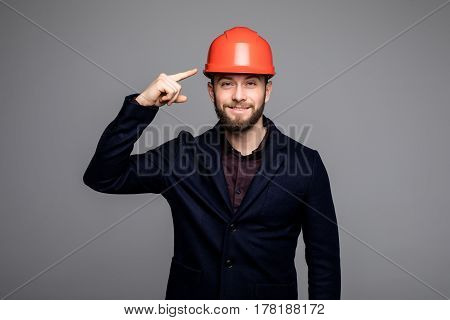 Young Construction Worker Pointed On Hard Hat