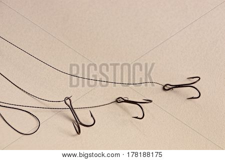 Set of hooks and fishing line on a gray surface