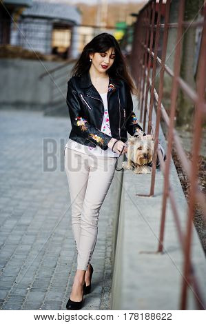 Brunette Gypsy Girl With Yorkshire Terrier Dog Posed Against Steel Railings. Model Wear On Leather J