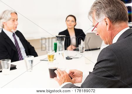 business team sitting in a meeting in conference room